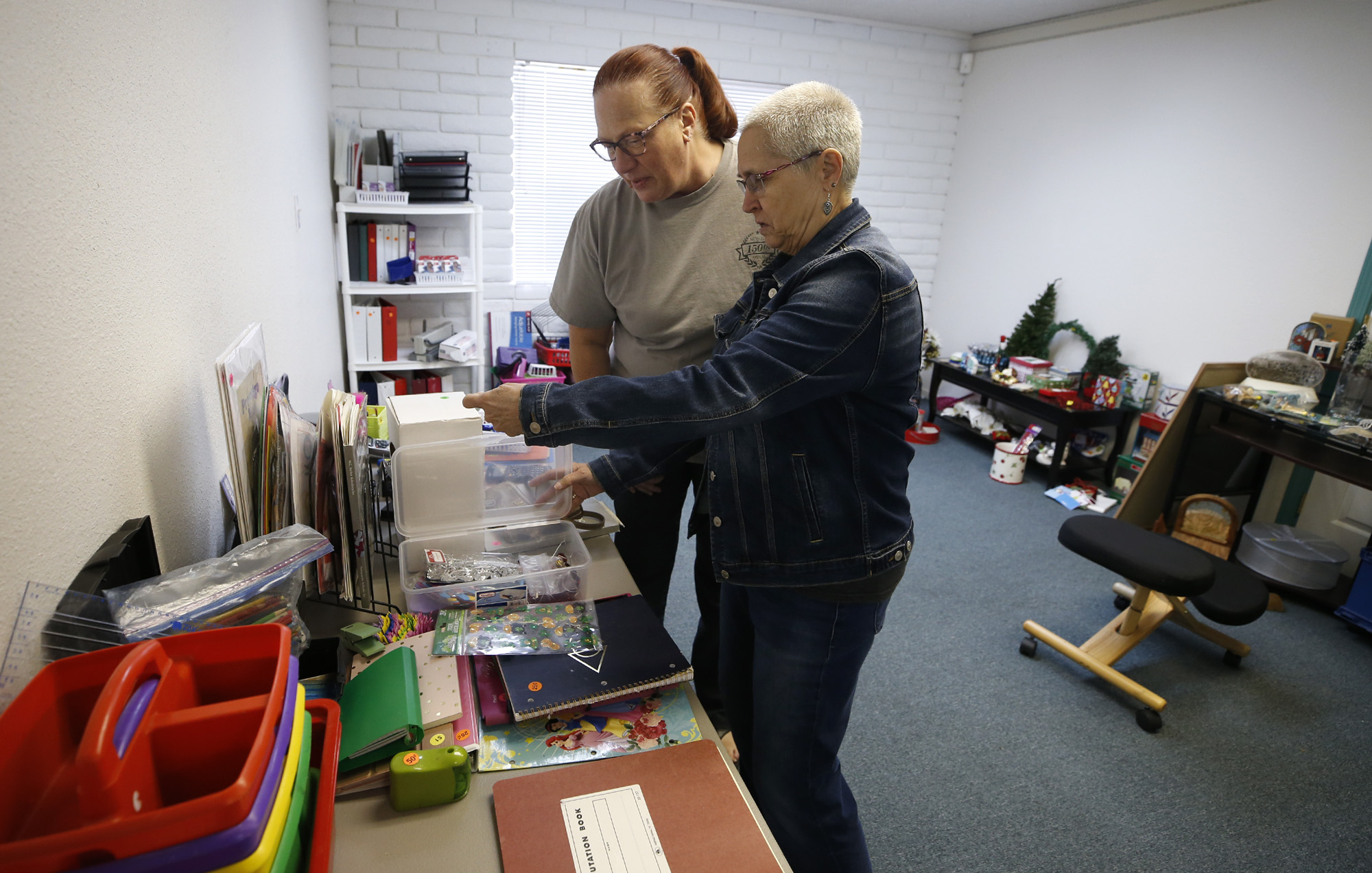Chauna Renaud and Vickie Polzien look through items at the rummage sale benefitting Lighthouse Lodge, in Carson City, Nev., on Saturday, June 13, 2020. Organizers hold a weekly BBQ and ongoing rummage sale to raise funds for creating a re-entry program for Carson City women being released from incarceration.  Photo by Cathleen Allison